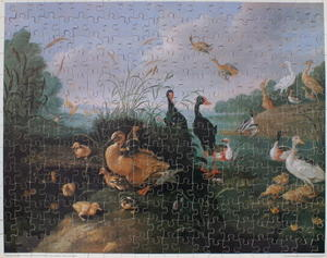 Decorative Fowl Round A Lake With Ducks And Ducklings By A Reeded Bridge.